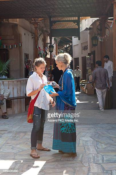 Mother & daughter look at purchases, gold souk