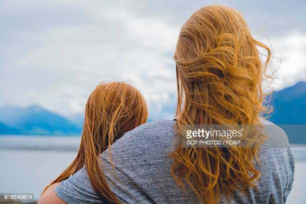 Mother & daughter looking at lake