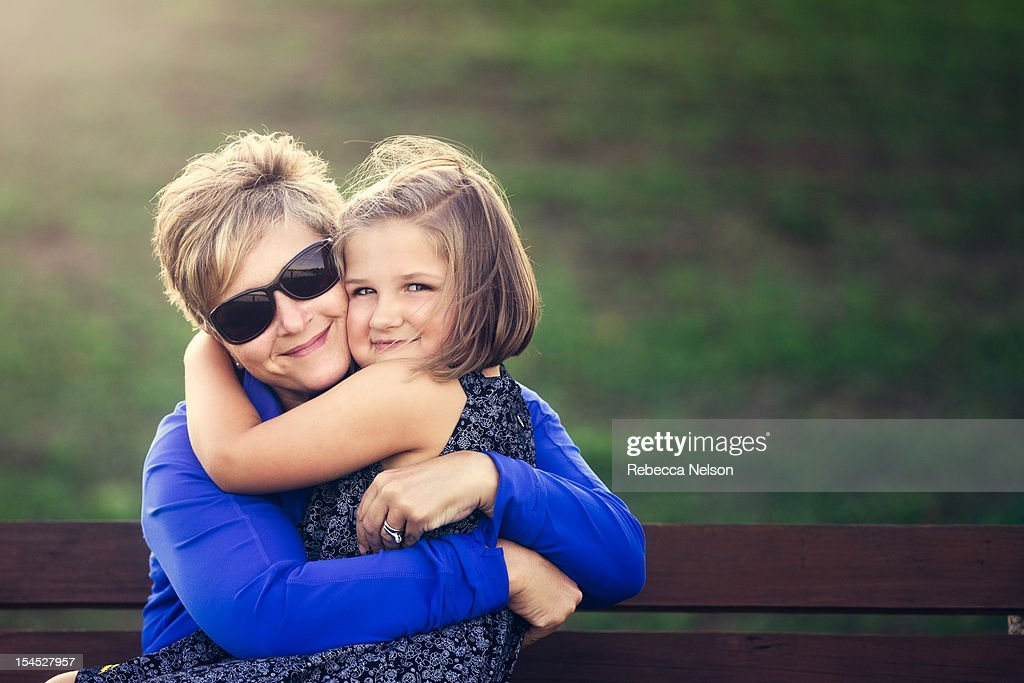 Mother & Daughter on park bench : Stock Photo