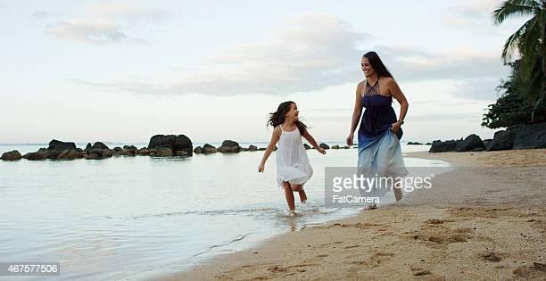 Mother & Daughter Playing at the Beach