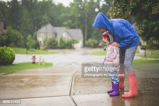 Mother daughter playing the da rain