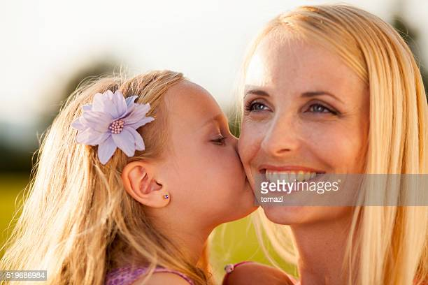 Mother - daughter sweet kiss