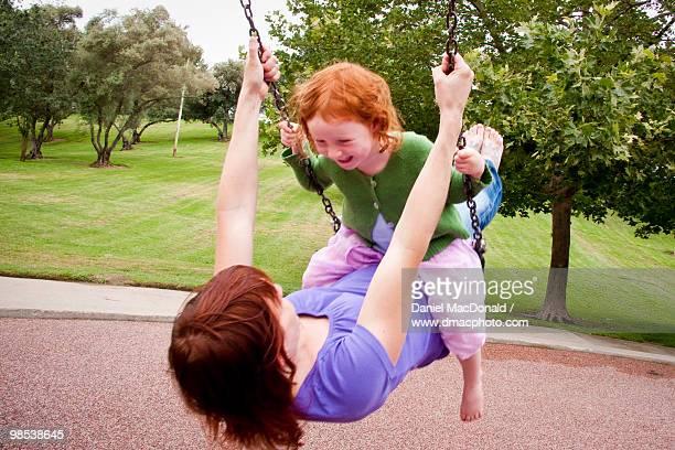 Mother & Daughter Swinging Together