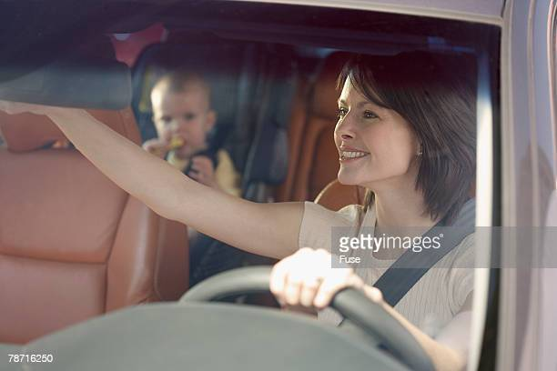 Mother Driving with Infant Daughter