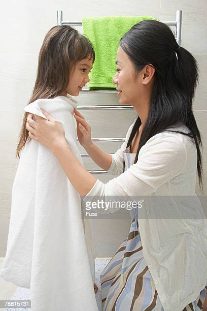 Mother Drying Daughter with Towel