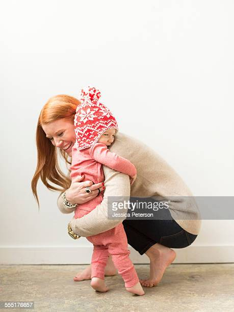 Mother embracing baby son (2-3)