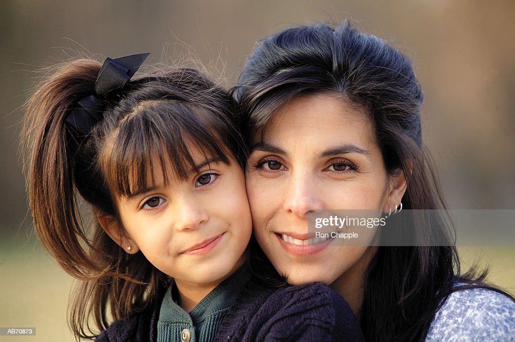Mother embracing daughter (6-8), portrait : Stock Photo