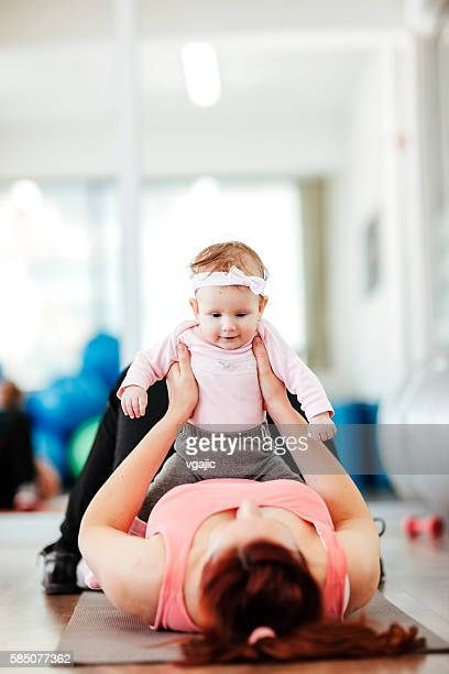 Mother Exercising with Her Babies in the Gym