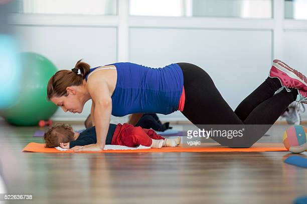 Mother Exercising with Her Baby in a Gym