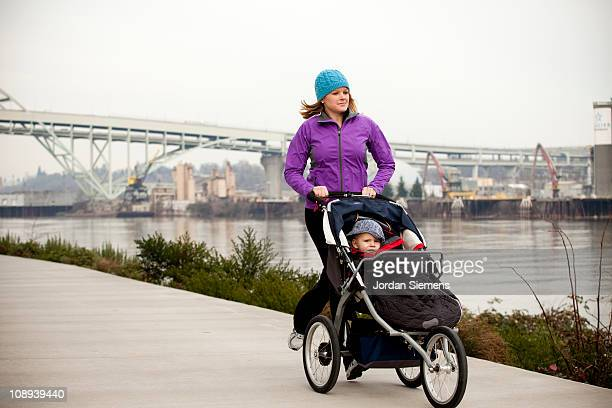 Mother exercising with her young child.