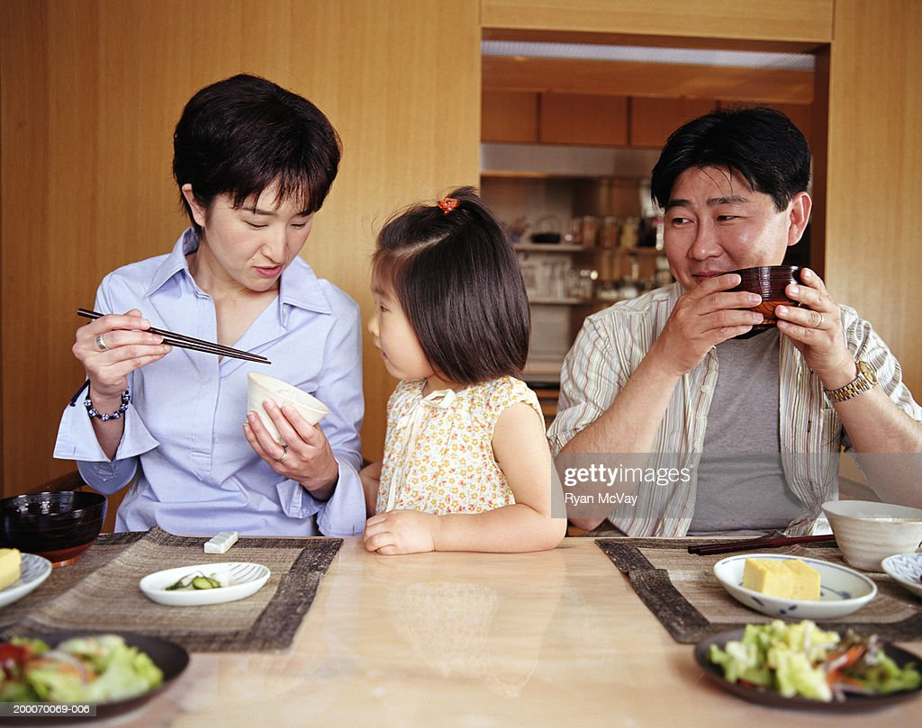 Mother, father and daughter (2-4) eating meal at home : Stock Photo
