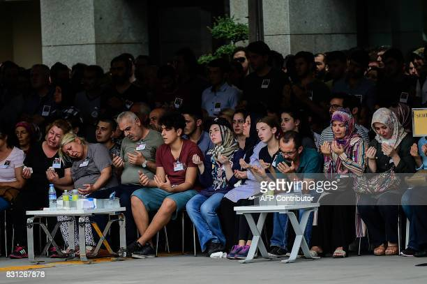 Mother father and relatives of Turkish police officer Sinan Acar killed last night mourn during his funeral ceremony at Istanbul's police department...