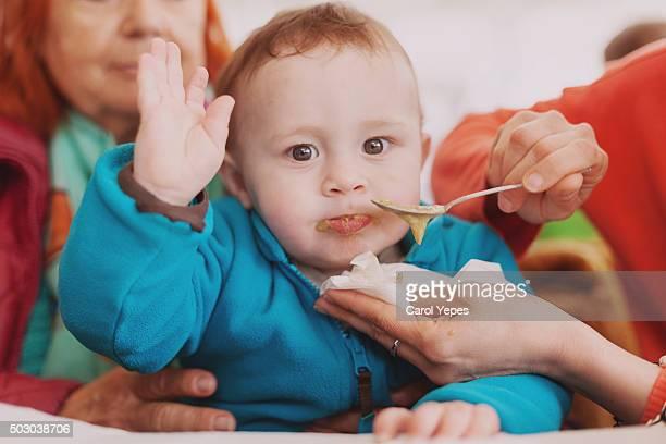 mother feeding baby son