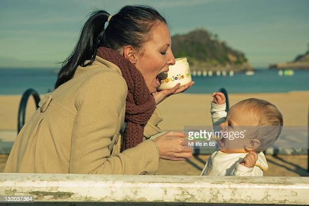 Mother feeding son