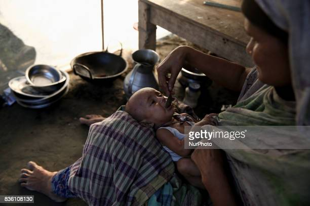 A mother feeds her child in a makeshift camp in Guthail Jamalpur Bangladesh on 19 August 2017 Pure drinking water and medicine are highly demanded in...