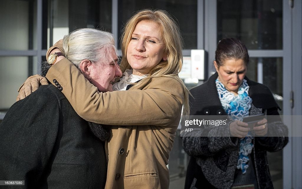 A mother from Srebrenica cries in front of the Yugoslav War Crimes Tribunal (ICTY) in The Hague, The Netherlands, on February 28, 2013, after the appeal judgement of Momcilo Perisic, the former chief of staff of the Yugoslav army. A UN war crimes tribunal acquitted Yugoslav ex-army chief Momcilo Perisic on appeal and overturned his 27-year sentence for war crimes and crimes against humanity during the bloody Balkan wars of the 1990s. AFP PHOTO/ POOL KOEN VAN WEEL netherlands out