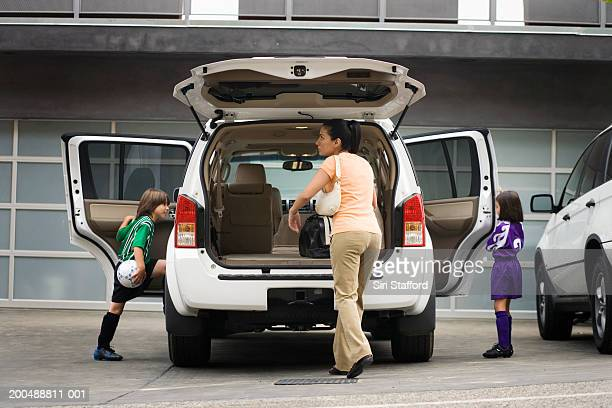 Mother getting children (6-10) to soccer practice