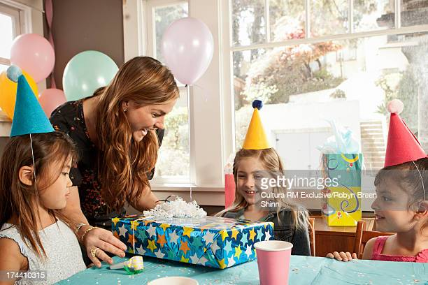 Mother giving child birthday present