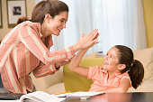 Mother giving daughter high five