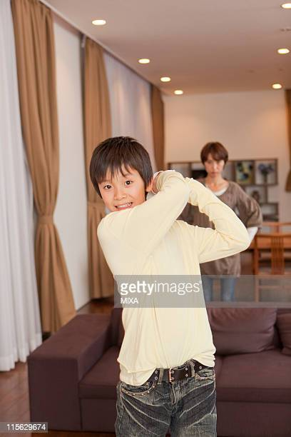 Mother Glaring Son Playing Video Game