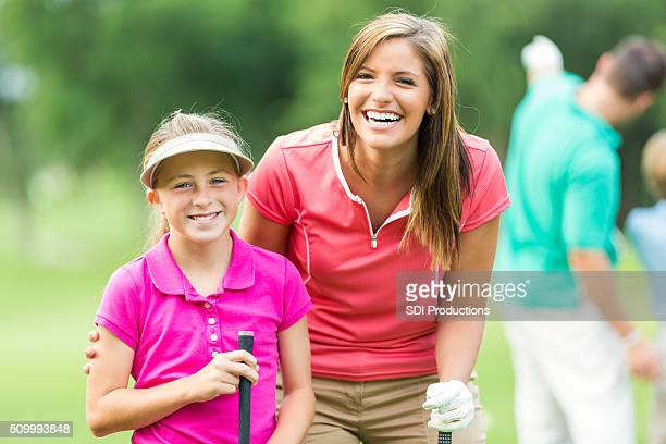 Mother have fun while playing golf together