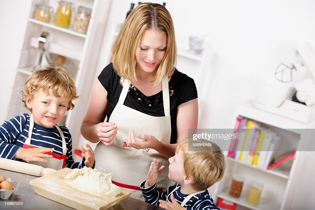 Mother Having Fun Day In The Kitchen With Her Sons : Stock Photo