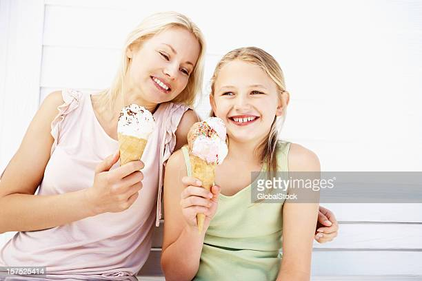 Mother having ice cream with her daughter