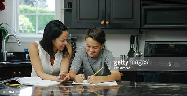 Mother Helping her Son with a Homeschooling Assignment