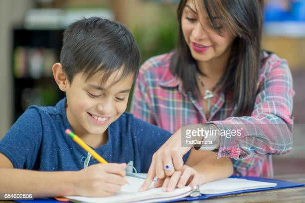 Mother Helping Son Study