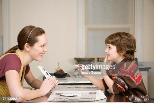 Mother helping son with mathematics : Stock Photo