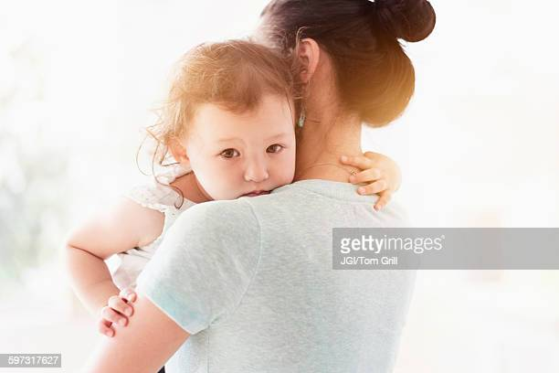 Mother holding baby daughter