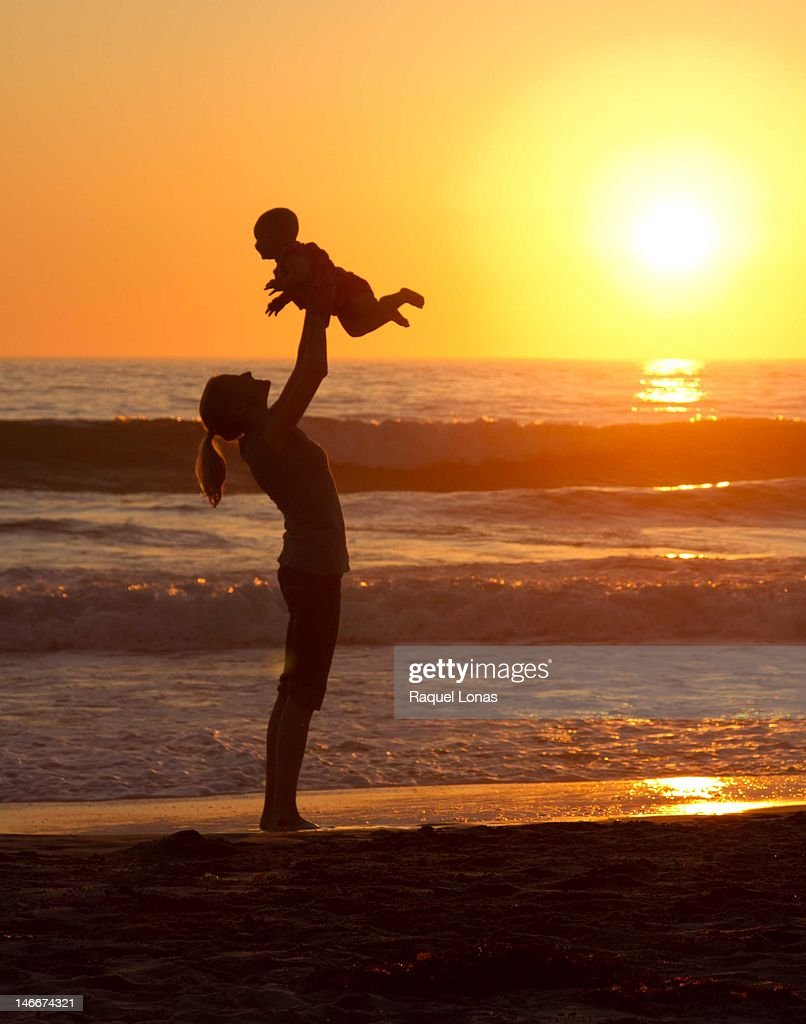 Mother holding baby in air : Stock Photo