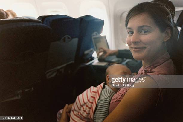 Mother Holding Baby on Plane