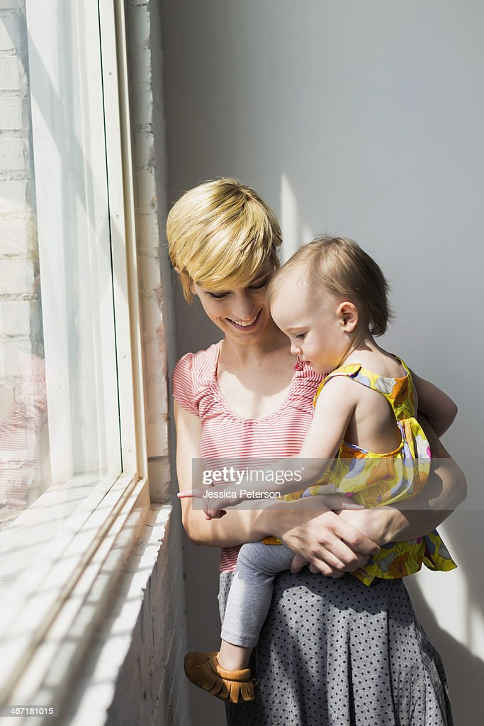 Mother holding daughter (12-17 months) : Stock Photo