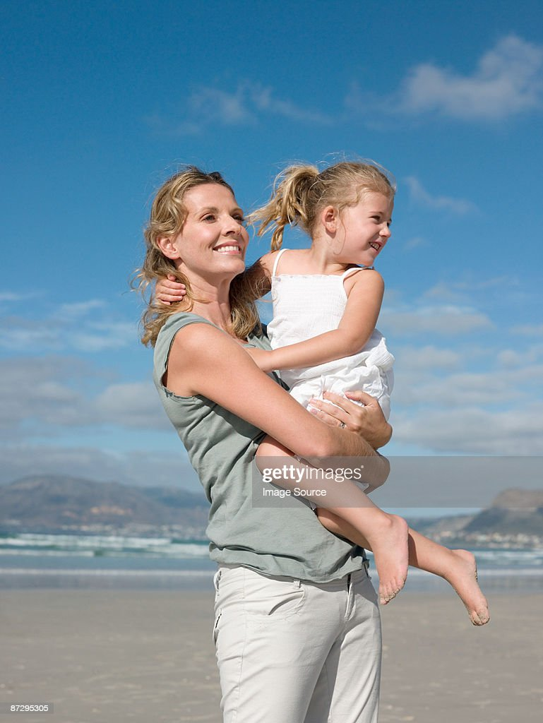 Mother holding daughter : Stock Photo