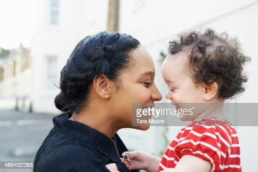 mother holding happy child