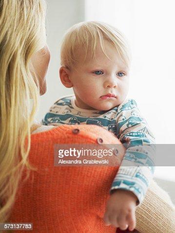 Sad Woman Holding Baby