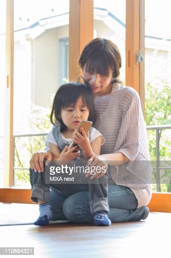 Mother Holding Son at Living Room : 스톡 사진