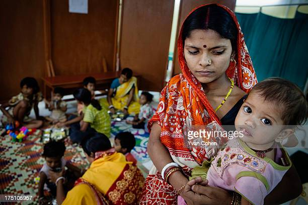 A mother holds her child at a diarrhea treatment centre set up and run by the nonprofit organisation Calcutta Kids Calcutta Kids is a public health...