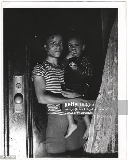 A mother holds her child in a window Harlem New York New York 1943 'This tragic picture is of that evil thing race hatred Mrs Bernice Lythcott and...