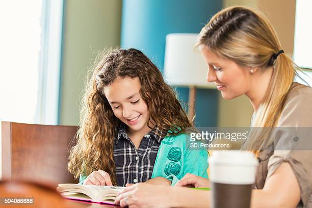 Mother homeschool elementary age daughter in public library