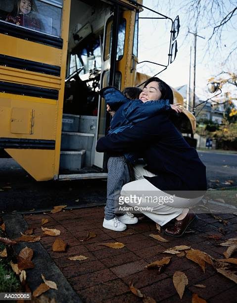 Mother Hugging Daughter at the School Bus