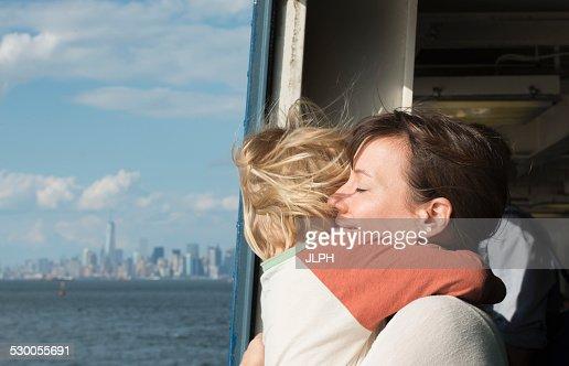 Mother hugging son on boat