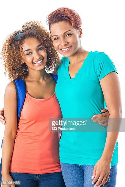 Mother hugging teenage daughter on her first day of school
