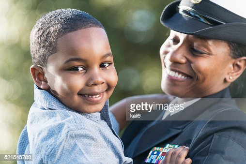 Mother in navy officer uniform holding son