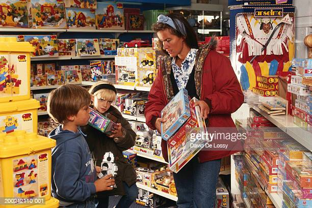 Mother in toy store with children