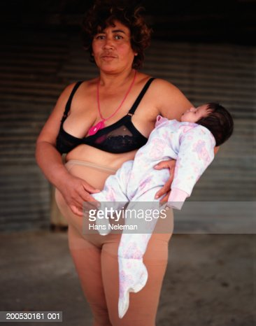 Mother in underwear holding baby girl (9-12 months) : Stock Photo