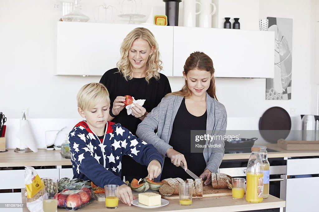 Mother & kids making healthy breakfast : Stock Photo