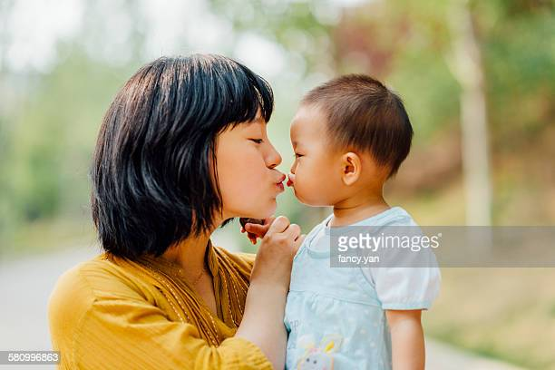 Mother kiss her daughter