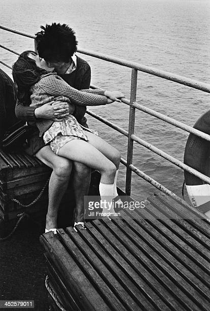 A mother kisses her daughter on the ferry between County Kerry and County Clare Ireland circa 1974